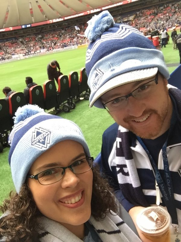 Couple Pitch-Side at Whitecaps Game