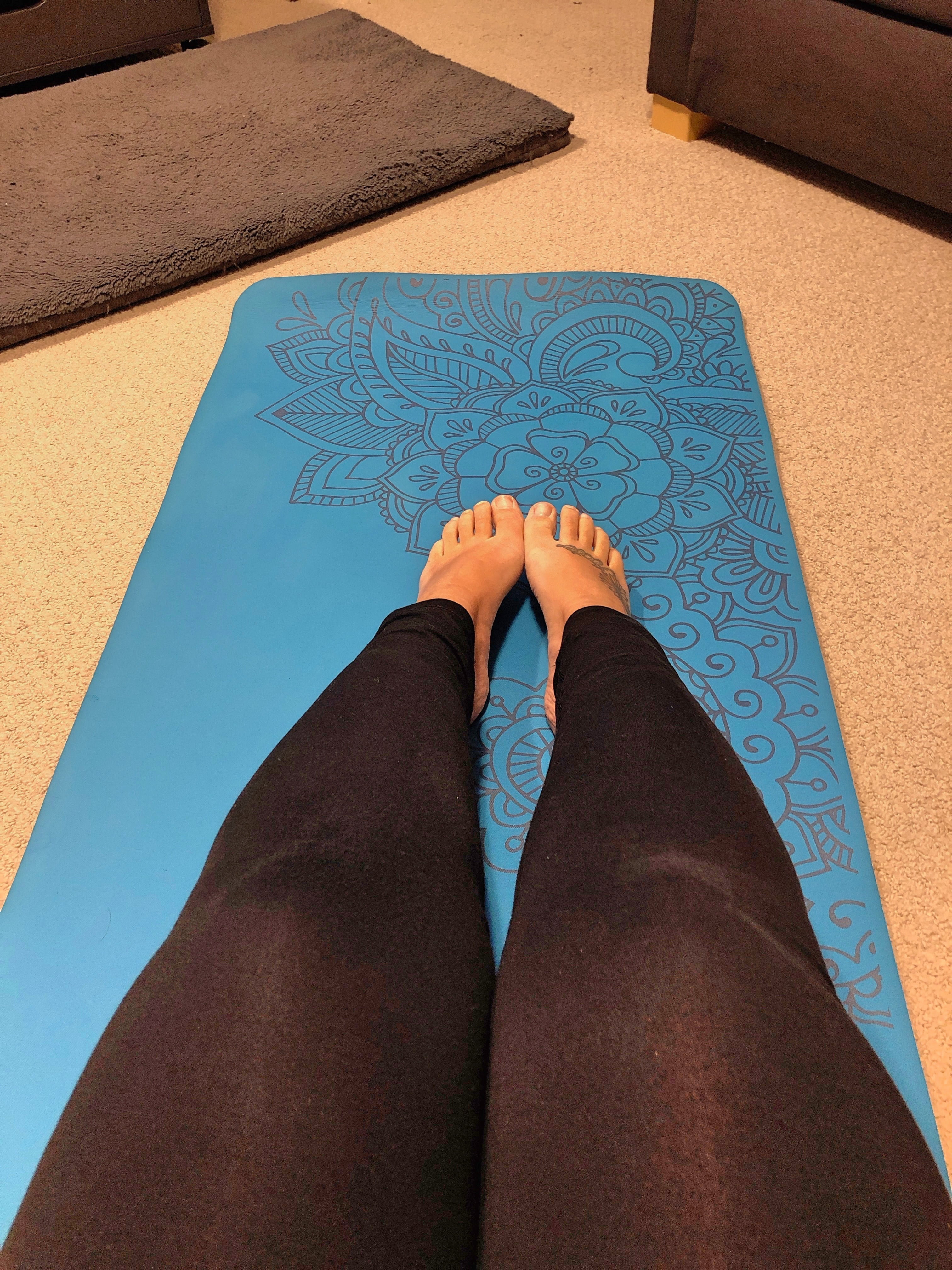Yoga Mat and Woman's Legs