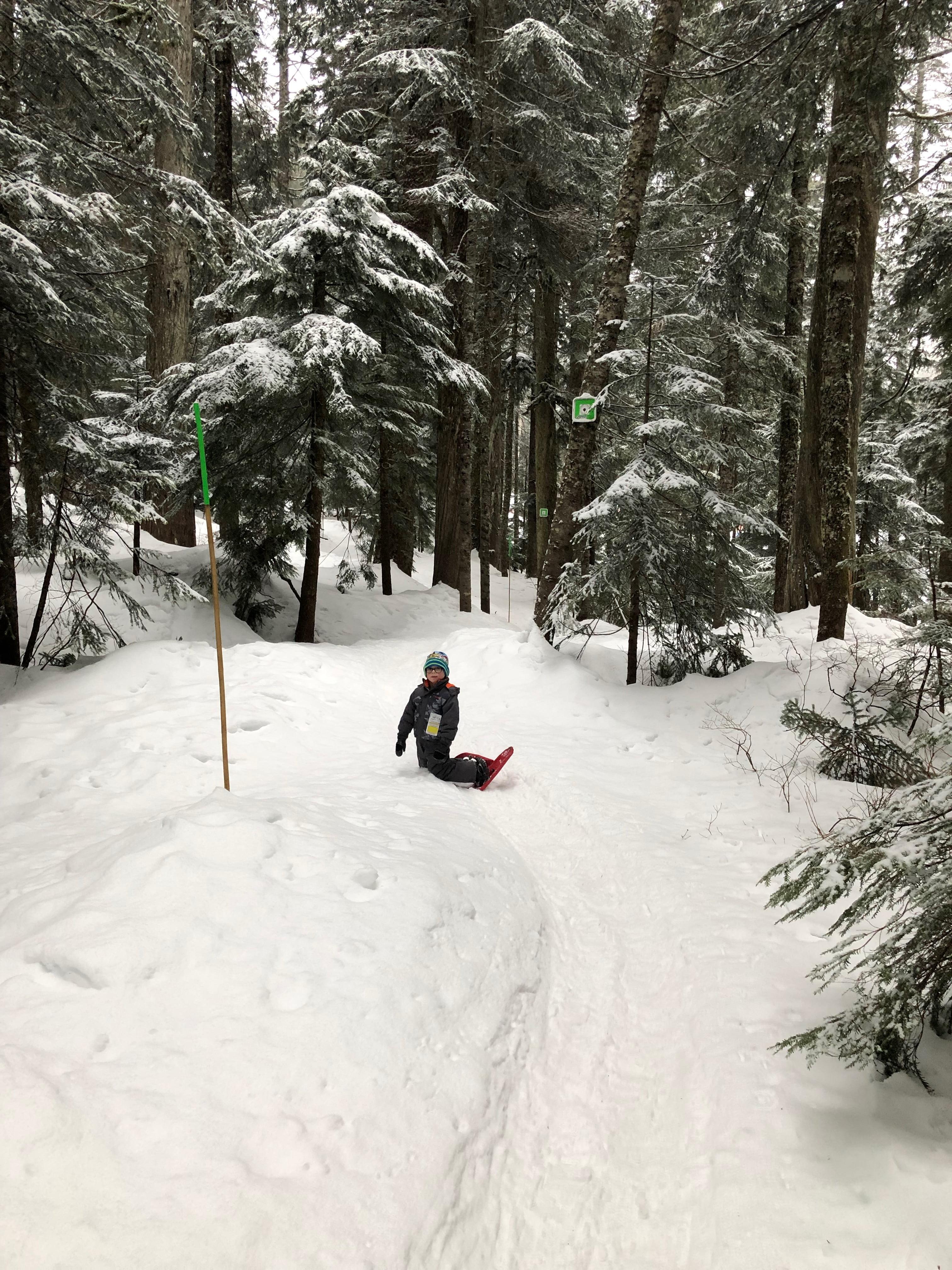 Kid Snowshoeing Taking Break on Knees