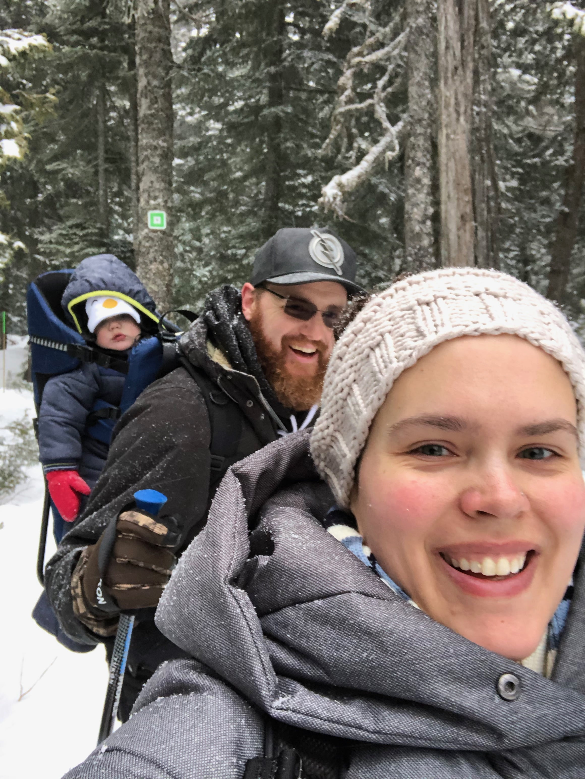 Family Snowshoeing with Baby in Carrier