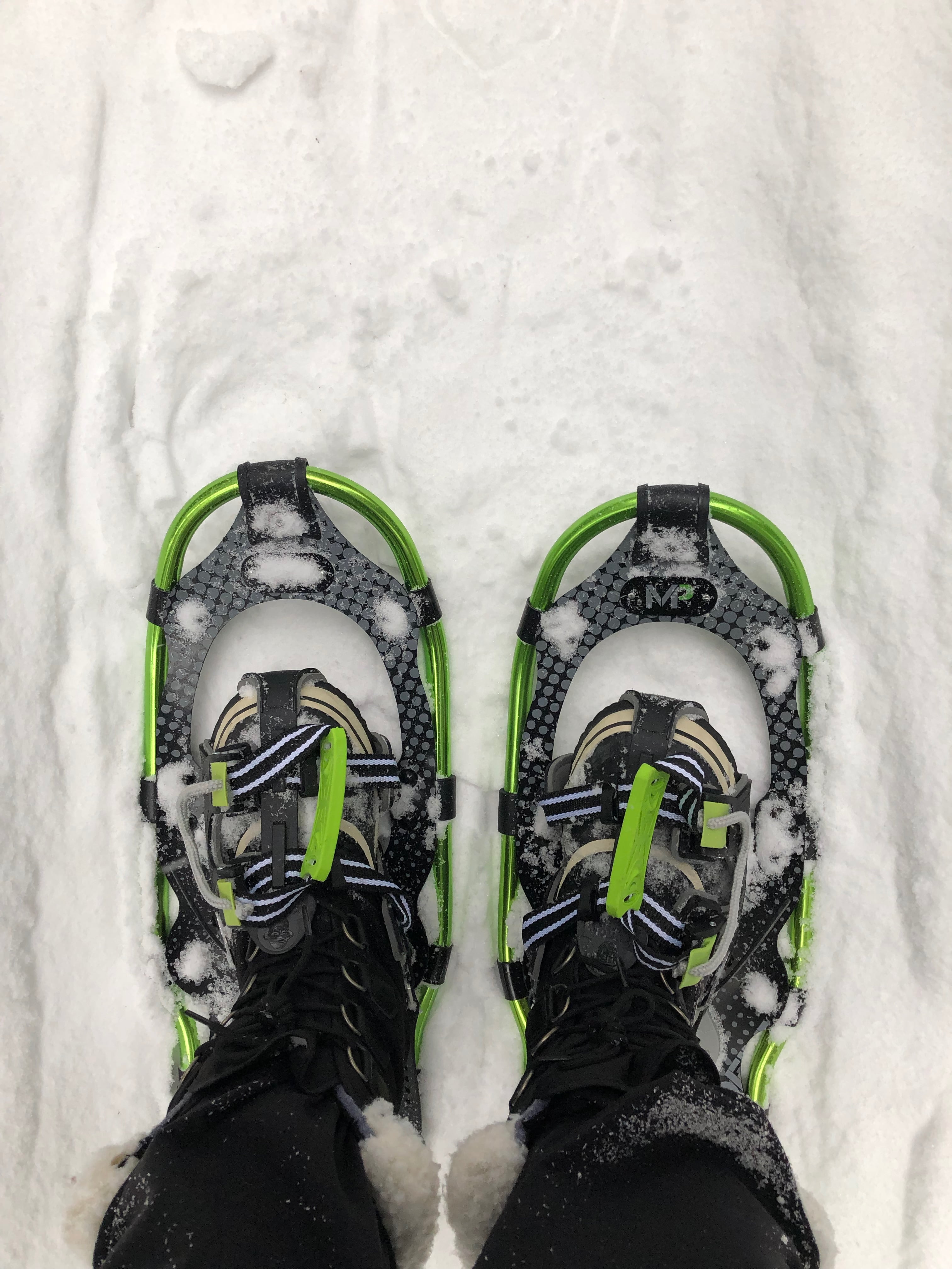Green Snowshoes on Woman's Feet