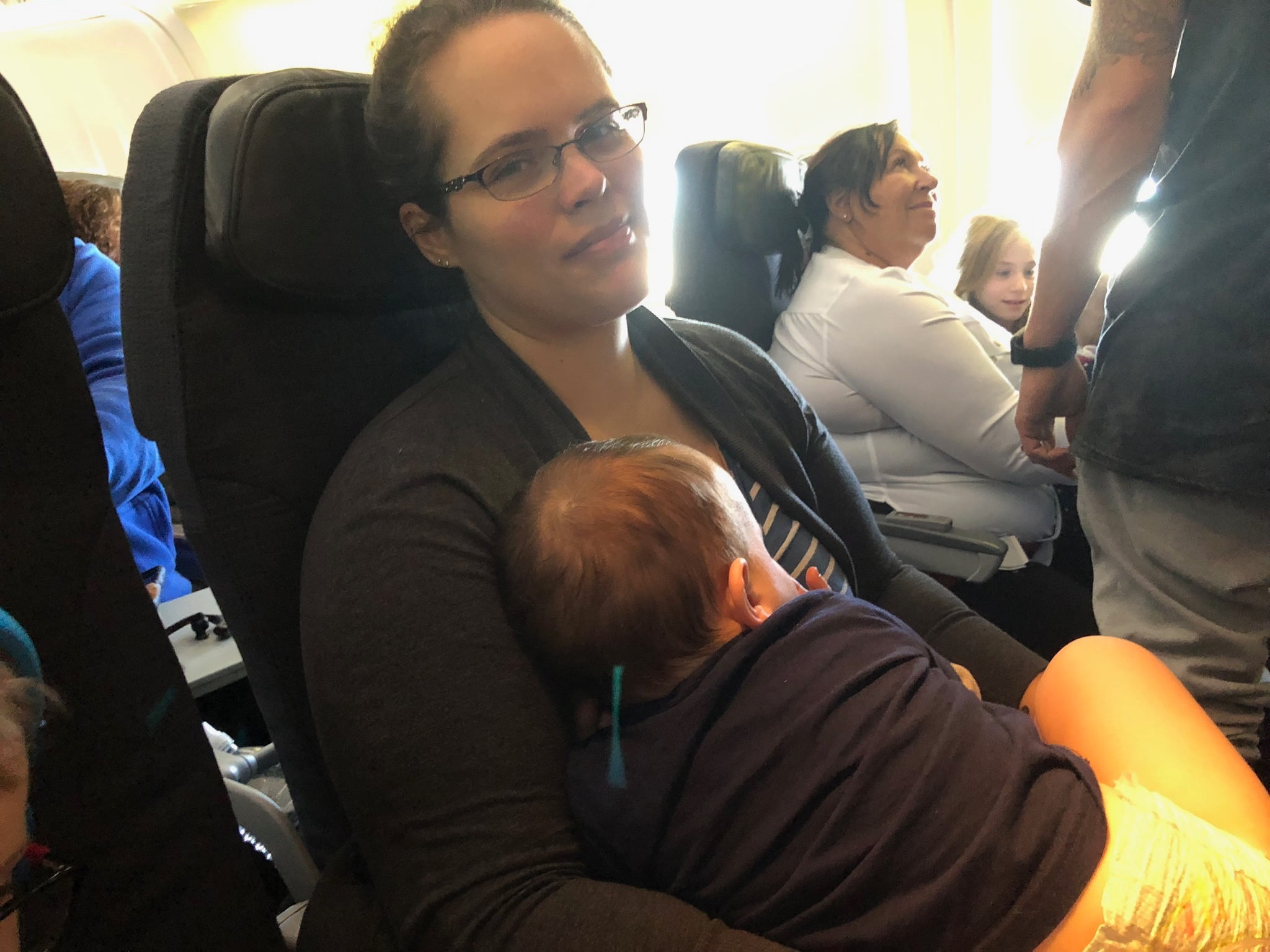 Mom and Toddler Snuggle on Airplane