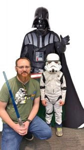 Boy in Stormtroopers Costume with Dad and Darth Vader