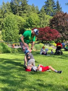 Dad Playing with Sons at Park