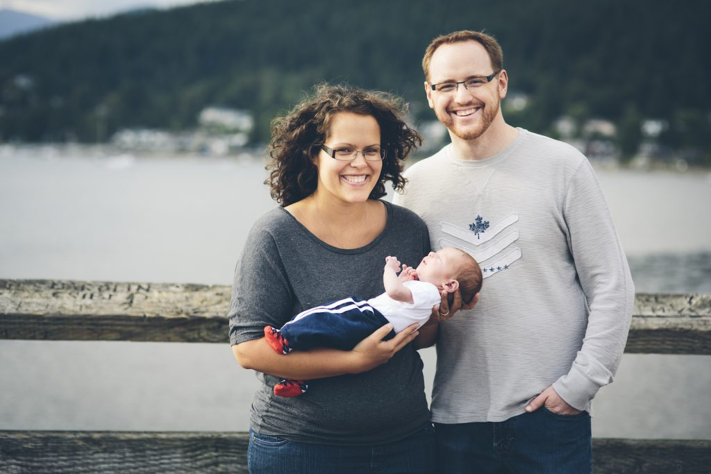 Parents Holding Baby at Rocky Point