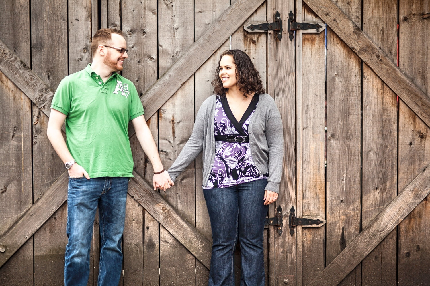 Young Newly Engaged Couple in Front of Barn Doors - Richard Giordano Photography