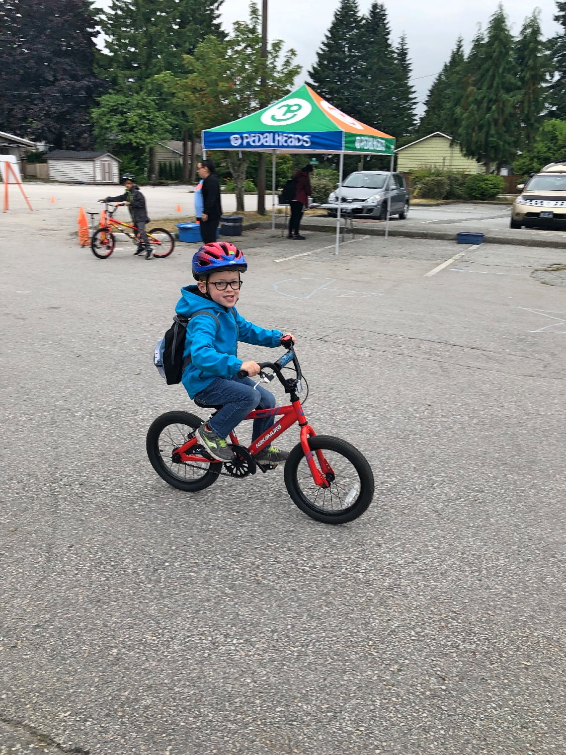 Boy Learning to Ride A Bike with No Training Wheels at Pedalheads Camp