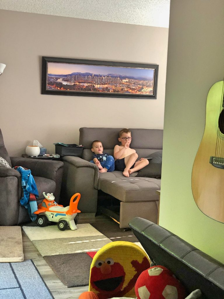 Brothers watching TV quietly on Couch