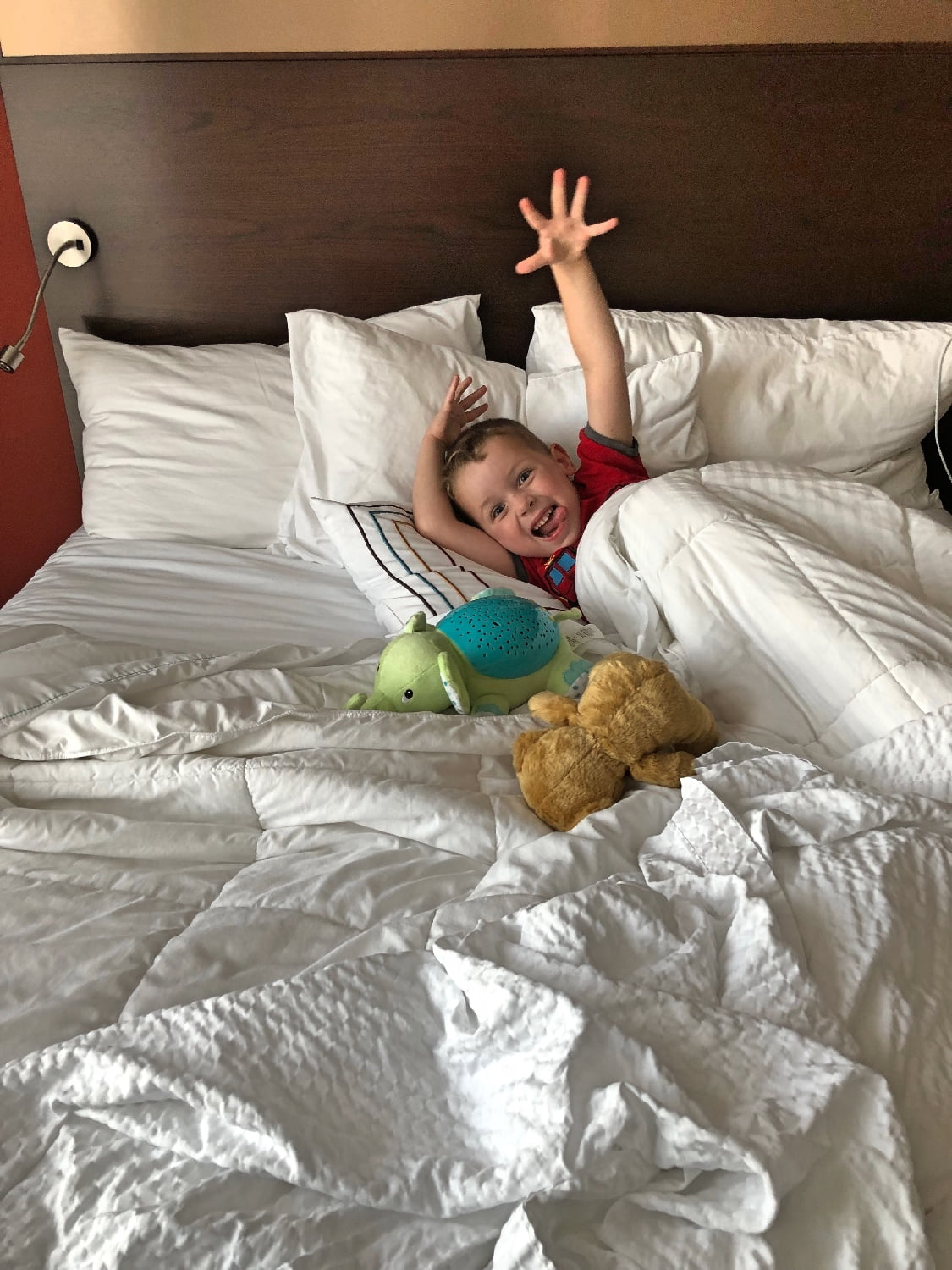 Kid Having Fun in Hotel Bed