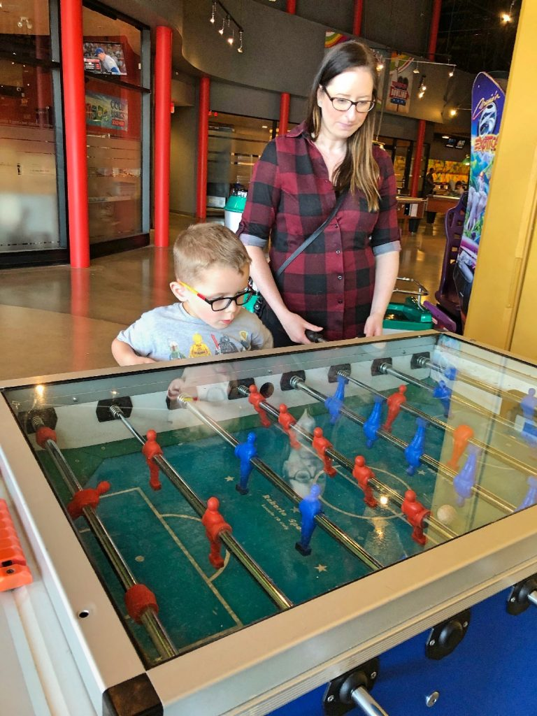Kid and Friend Playing Foosball
