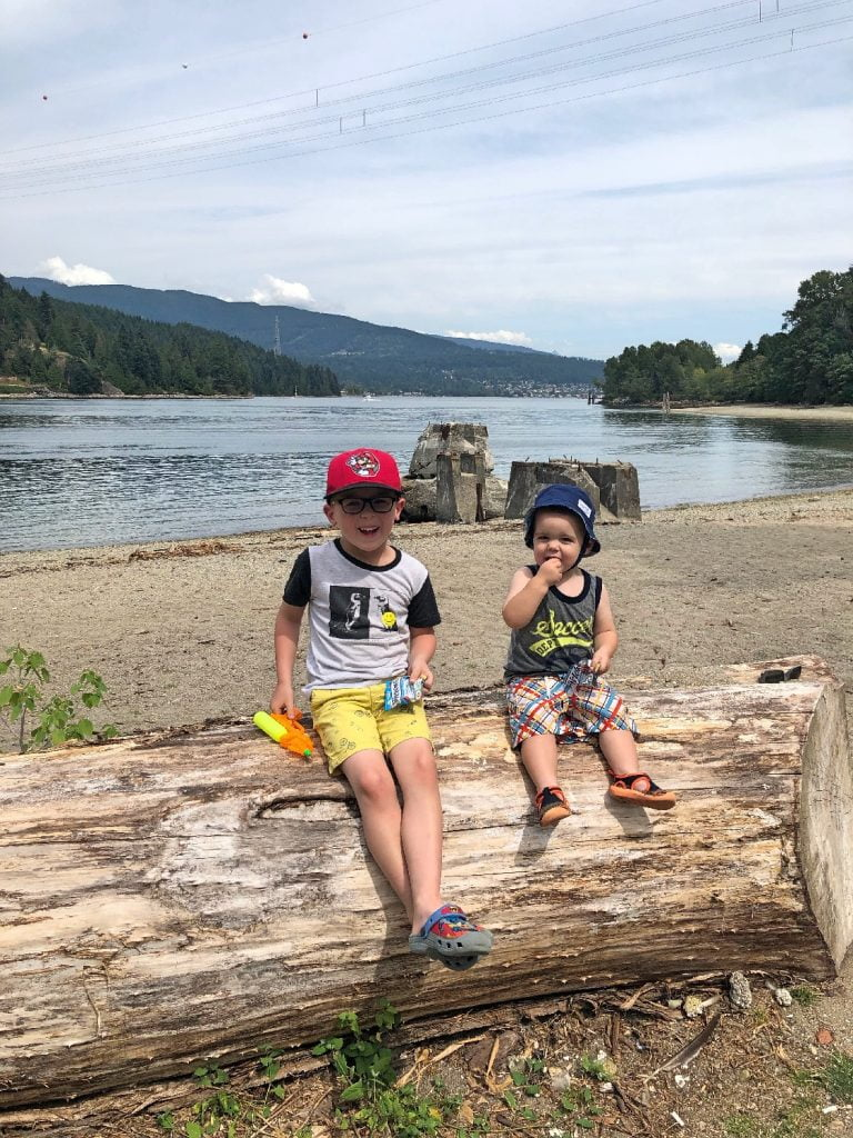 Kids Sitting on Log at Barnet Marine Park Beach