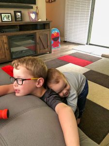 Toddler Hugging Brother from Behind