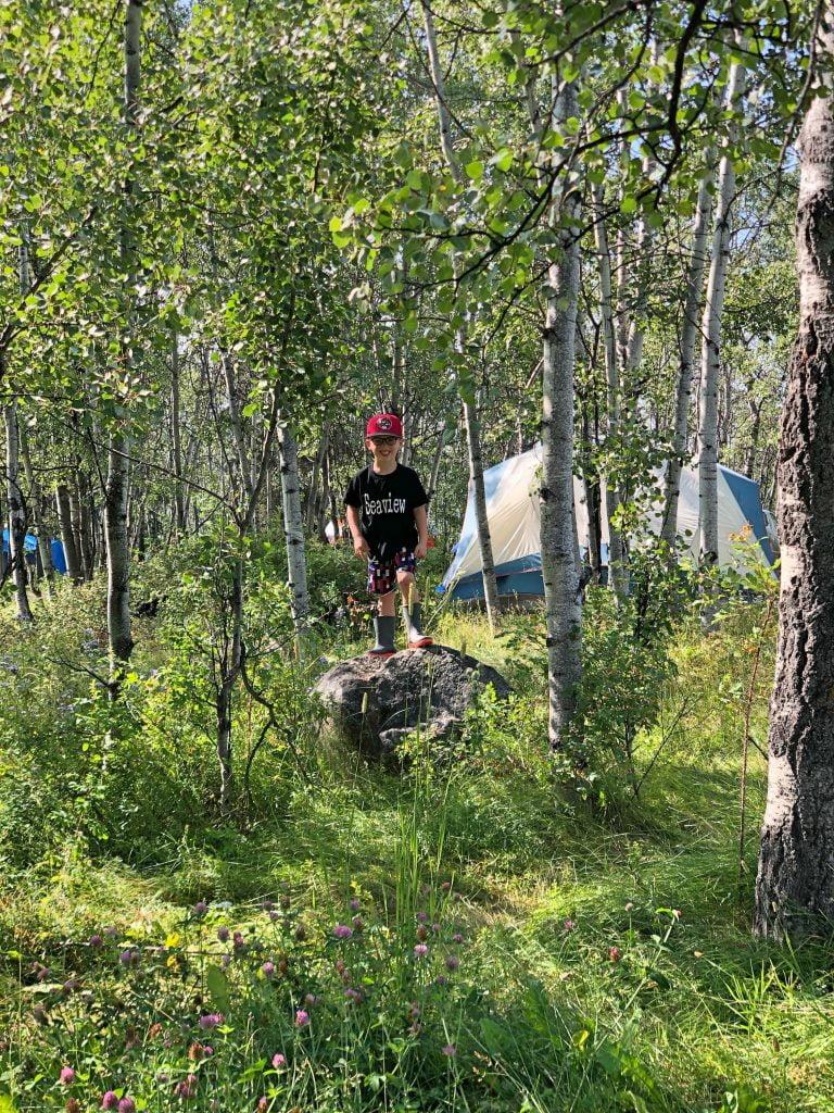Boy on Rock in Woods