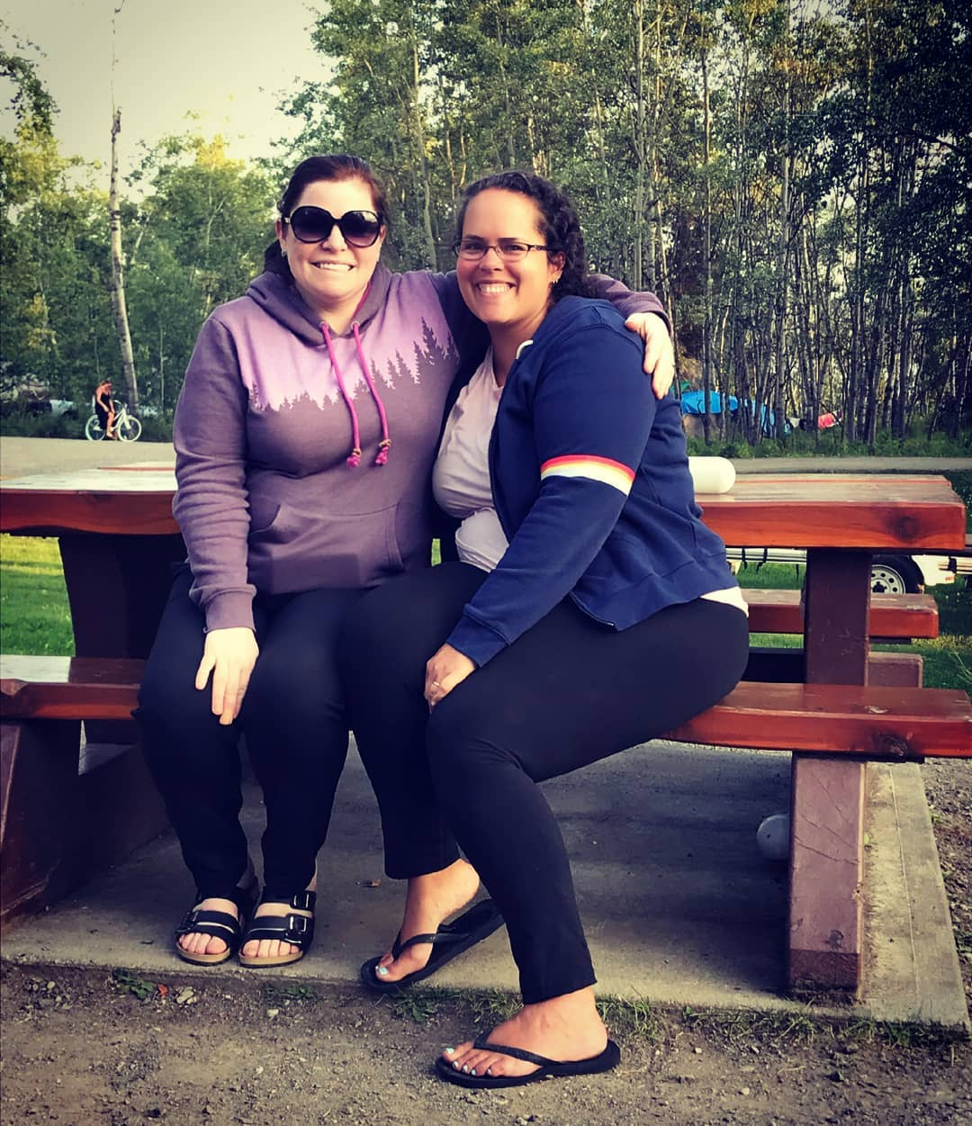 Camping with Friends - Two Ladies on Picnic Table