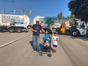 Car-Free Day Port Moody 2019 - Family Posing in Front of Recycling Trucks