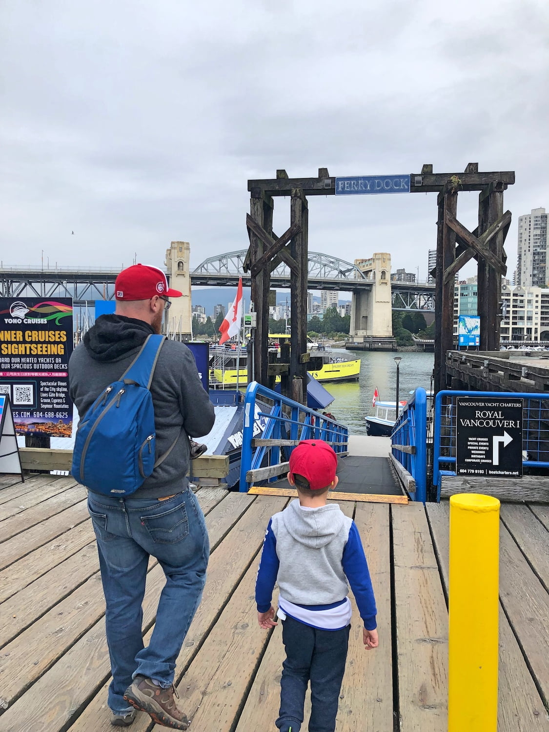 Dad and Kids Walking Onto Dock at Granville Island
