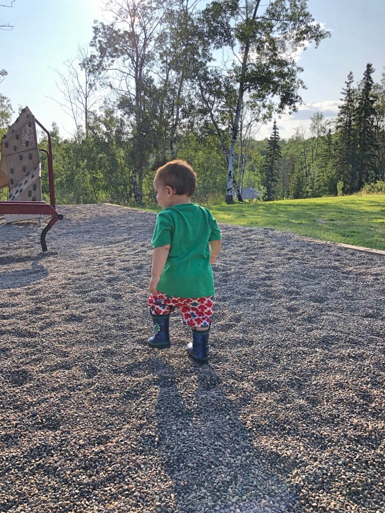 Toddler at Playground in Shorts and Boots