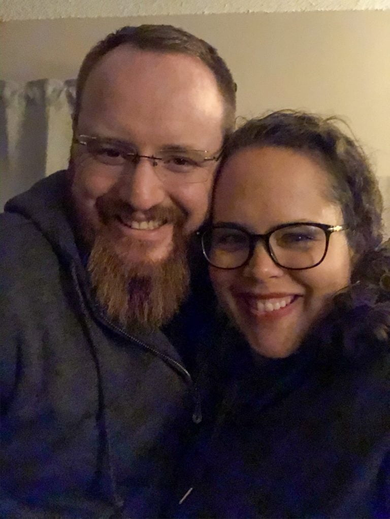 Bearded Man and Woman with Black Glasses Cheek to Cheek