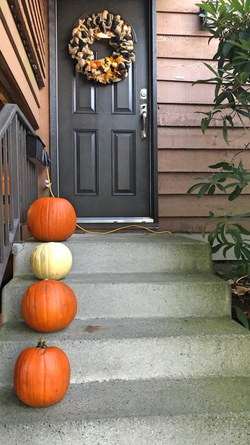 Doorstep with Uncarved Pumpkins and Fall Wreath