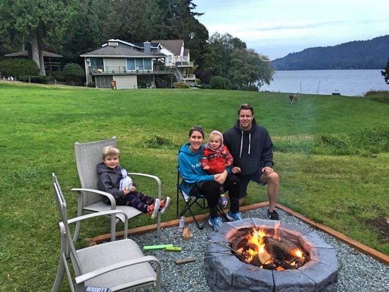 Family Sitting Fireside by Water: InHERview