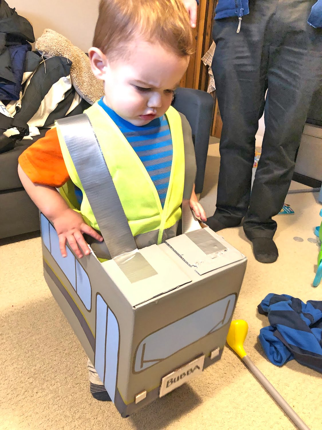 Toddler Unhappy in a Homemade Bus Costume