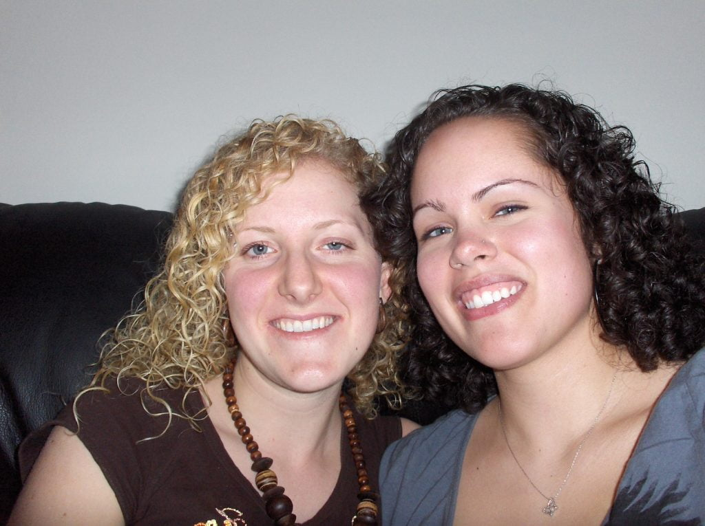 Blonde and Brunette Ladies with Curly Hair Smiling