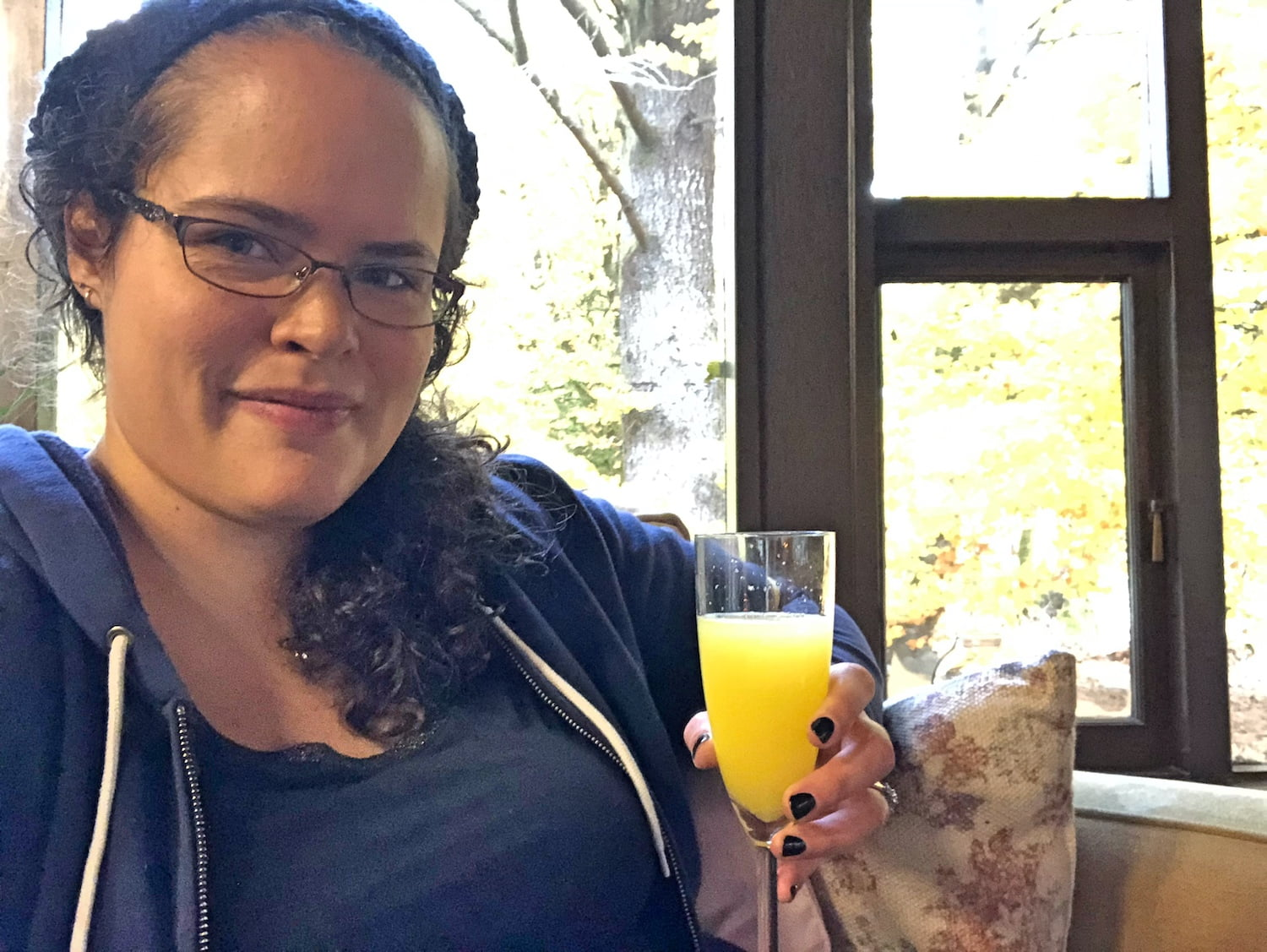 Brunette Woman Enjoying Mimosa
