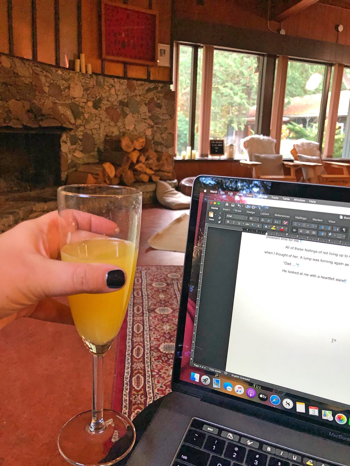Mimosa and Laptop in Fireside Lounge