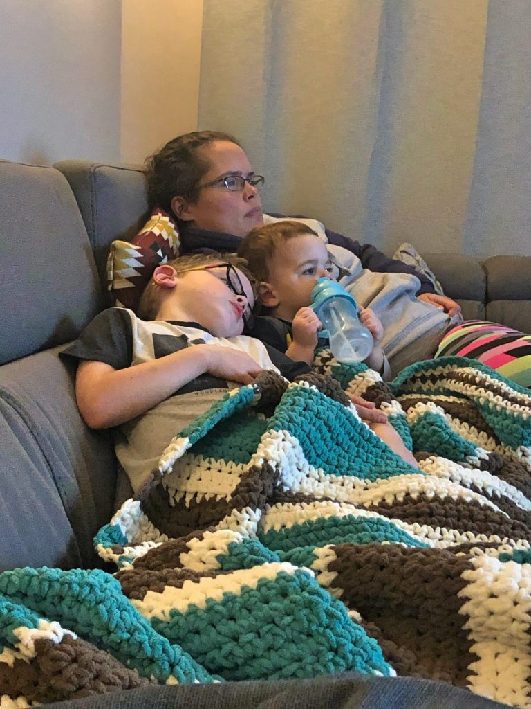 Mom and Two Sons Snuggling on the Couch