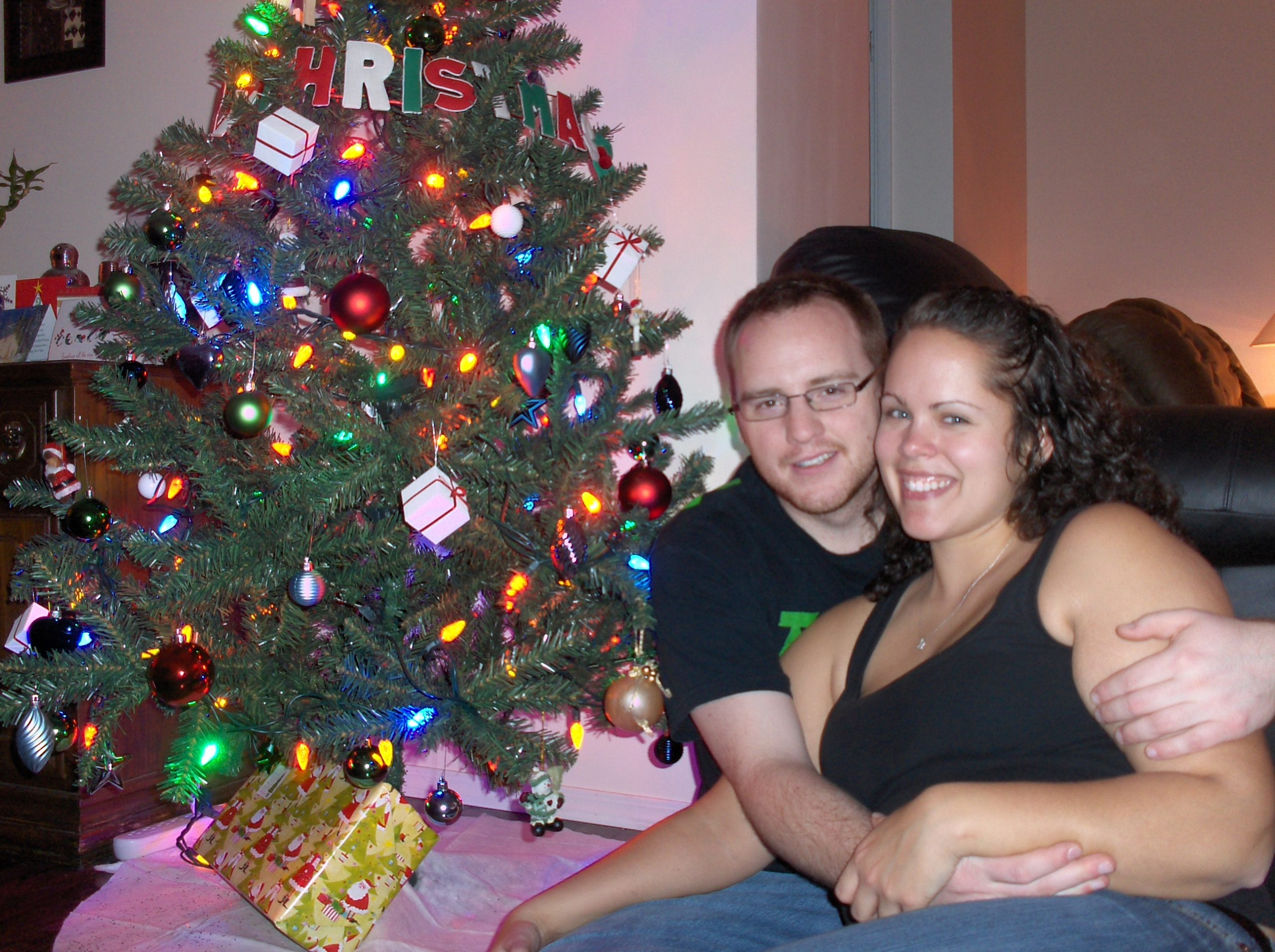 Couple Sitting by Christmas Tree 2009
