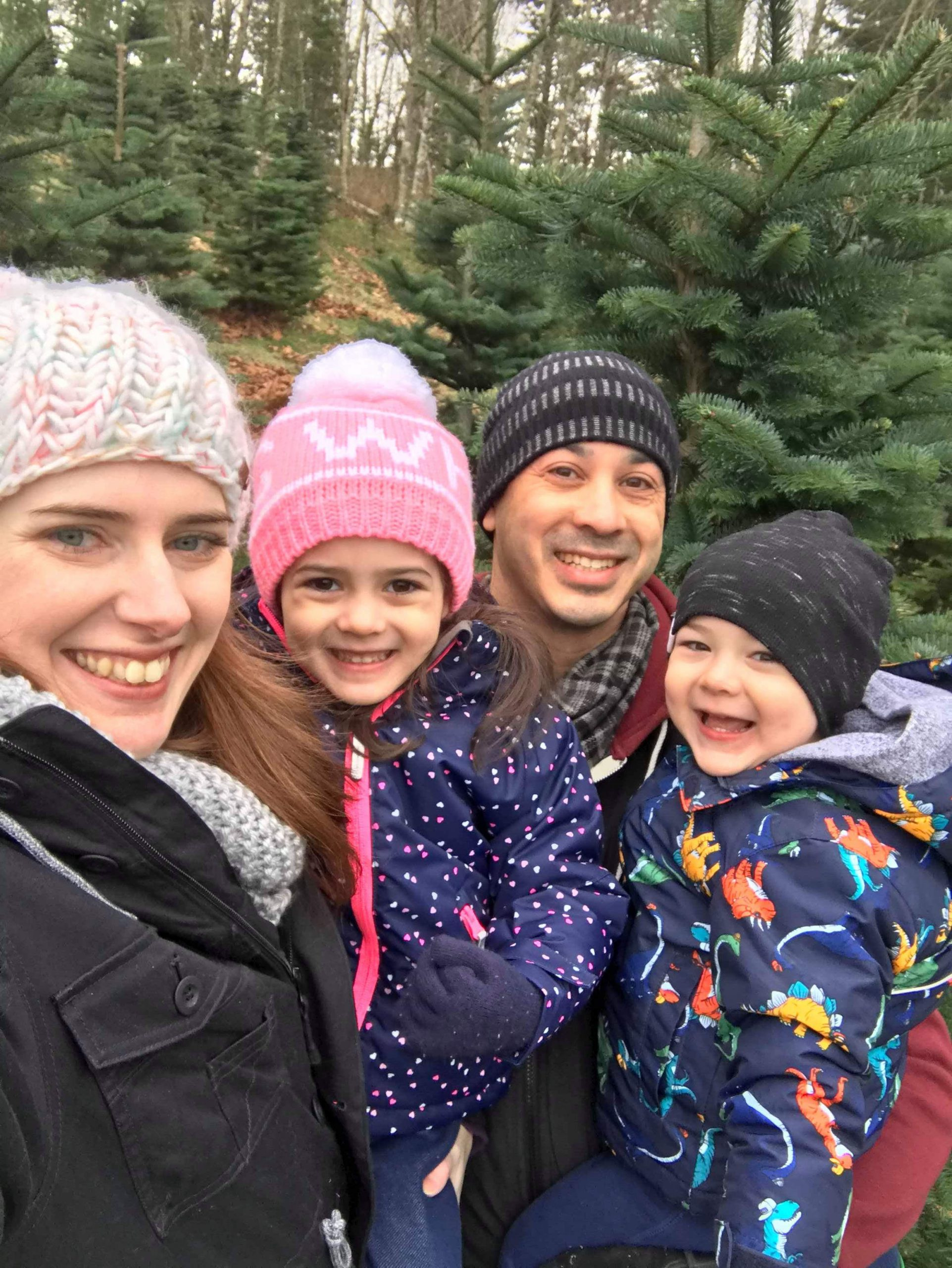 Happy Family of Four at Christmas Tree Farm