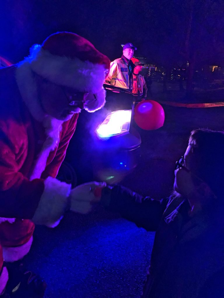 Kindergartner Shakes Hands with Santa