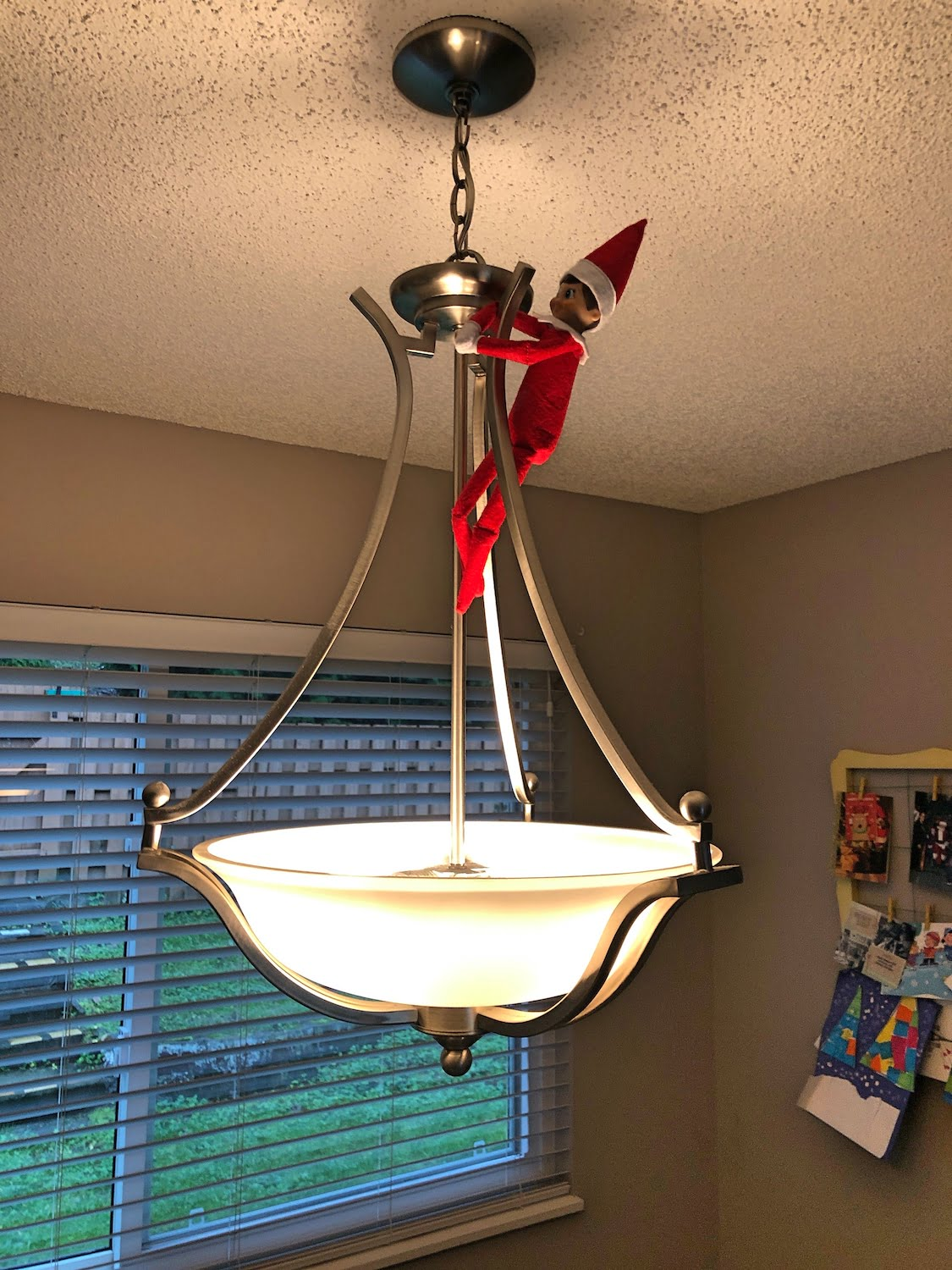 Jingle the Elf on a Shelf - Hanging from Light Fixture