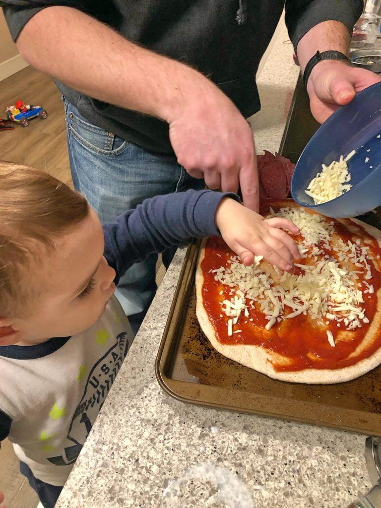 Toddler Helping Make Pizza