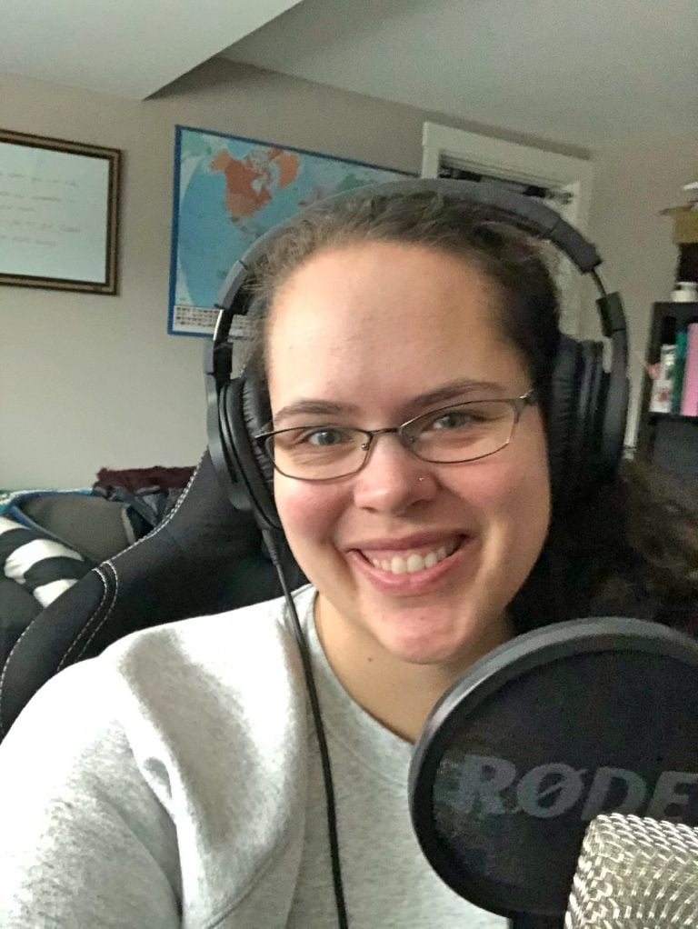Smiling Woman in Front of Recording Equipment