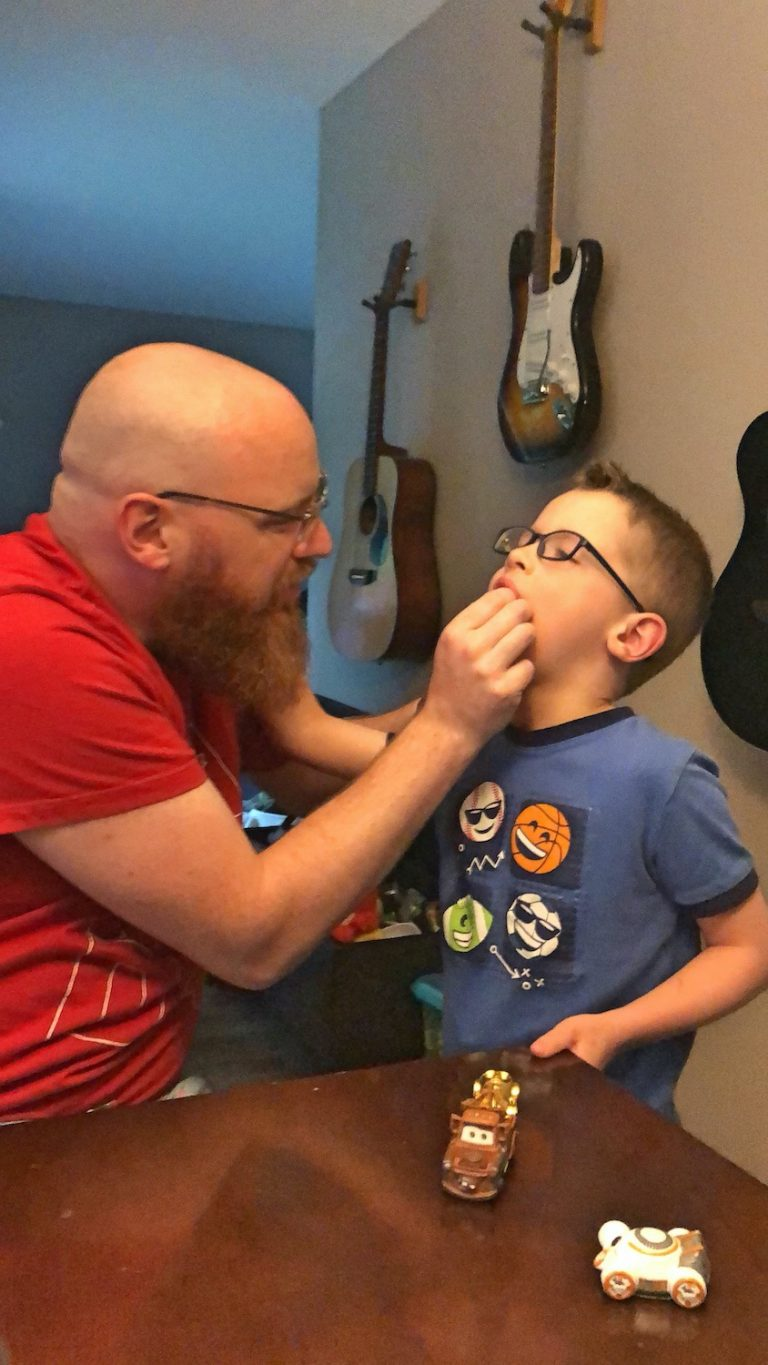 Dad Trying to Pull Out Kid's Tooth