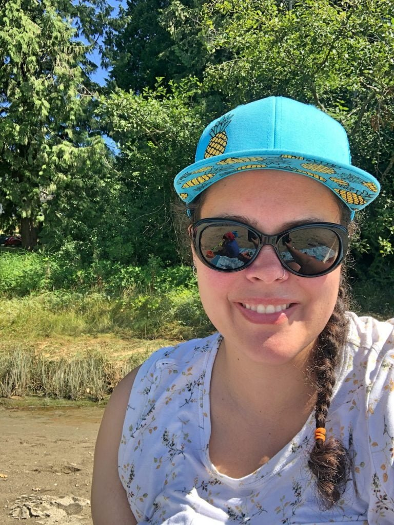 Smiling Anya Wyers Author in Sunglasses and Hat