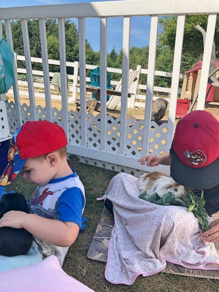 Kids Snuggling Guinea Pigs