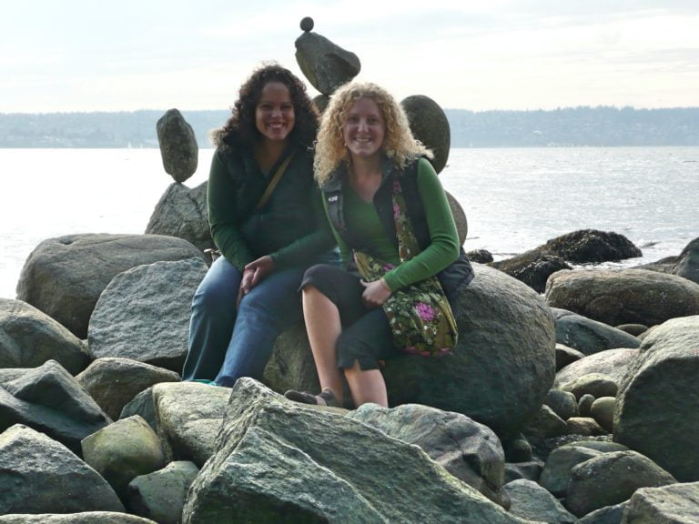 Brunette and Blond Sitting Near Inukshuks in Stanley Park (2007)