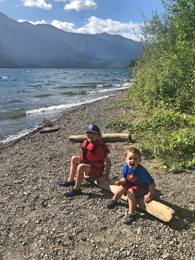 Kids Sitting on Log Lakeside