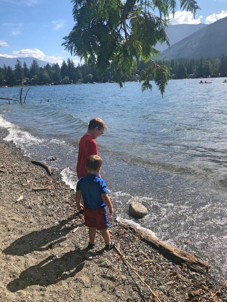 Kids on Beach Looking at Rocks