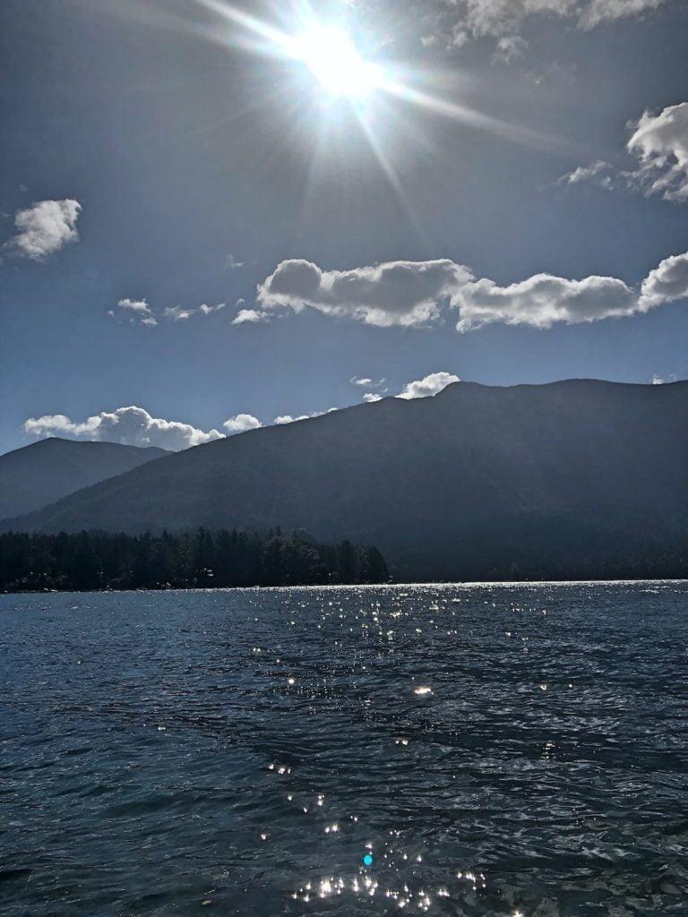 Sun Streaking Across Sky and Lake