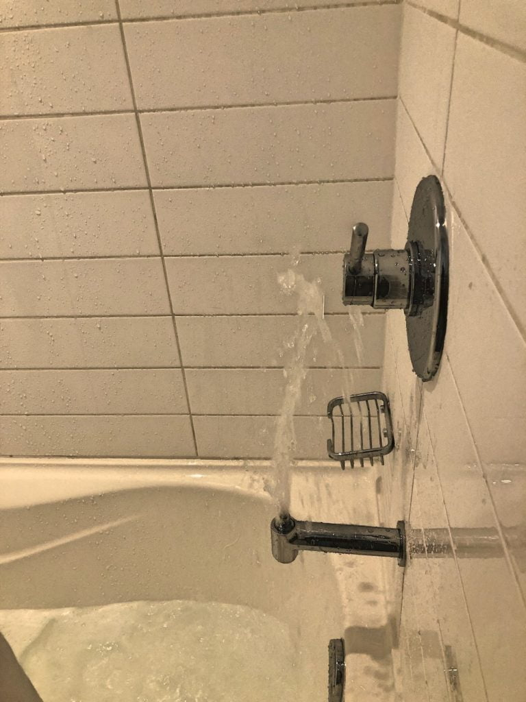 Water Shooting up from Bathtub Faucet