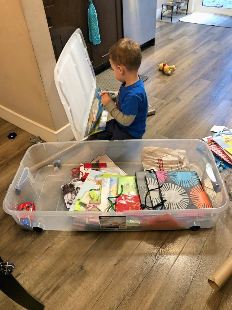 Mischeivious Toddler in Wrapping Paper Box