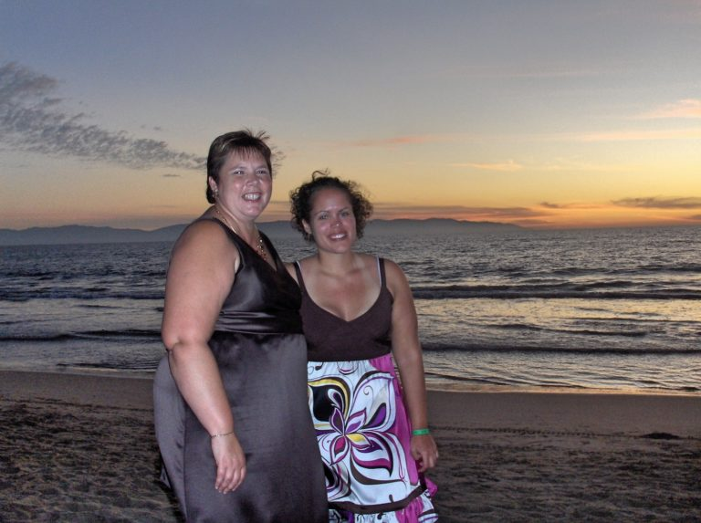 Mother and Daughter Dressed up On Beach