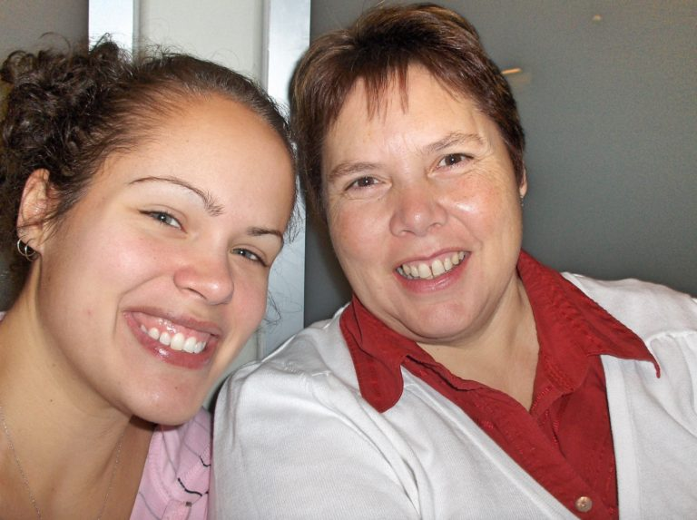Mother and Daughter, Smiling on Airplane