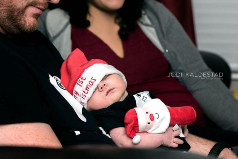 Newborn in First Christmas Santa Hat (2017)