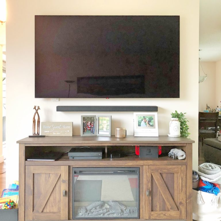 Entertainment Console with Fireplace Underneath TV