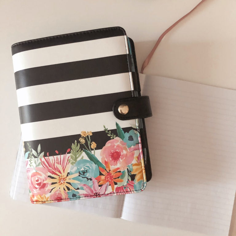 Striped Planner with Colourful Flowers on a Blank Notebook